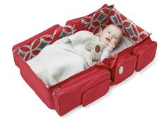 I would so love this in black or maybe a dark blue (Baby Travel - A Bag That Turns Into a Baby Couch)