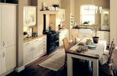 Wooden floors and a Belfast sink all add to the feel of this Country kitchen,