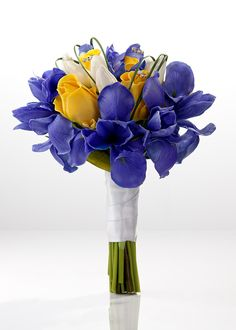 Blue iris bridal bouquet with yellow roses and white tulips-- I like this minus the yellow roses and butterfly charm thingies...