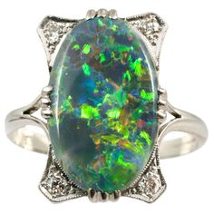 Black Opal Diamond Platinum Ring. Edwardian Black Opal and Diamond ring set in Platinum.