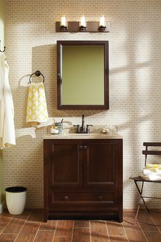 The Glacier Bay Delridge bathroom vanity combo features a rich chocolate finish and is accented with rubbed bronze cabinet hardware. The Delridge Collection is as beautiful as it is durable.