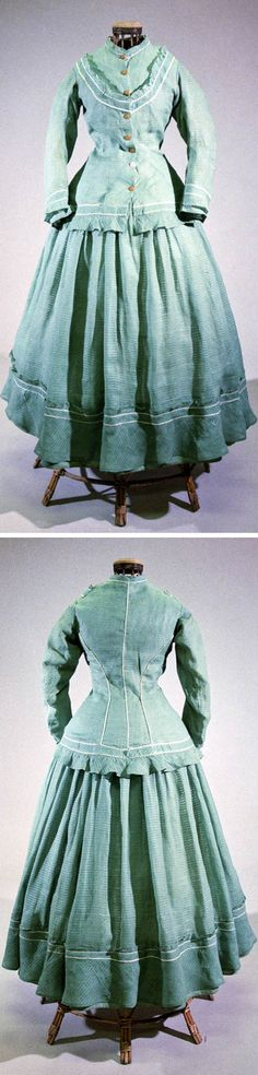 Walking dress, Bohemia, ca. 1863. Machine- and hand-sewn from cotton w/green embroidered reinforced strip. Extended tailored jacket w/small stand-up collar, front closure w/8 buttons in thoracic curve applied to white-lined waistband w/frilly ruffles. Rear part princess-cut at seams w/dual white piping. Long narrow sleeves jacket's bottom edge decorated w/frilled hem. Frilled skirt at waist. Bodice lined w/beige cotton canvas. North Bohemian Museum, Liberec, Czech Republic, via eSbírky.cz