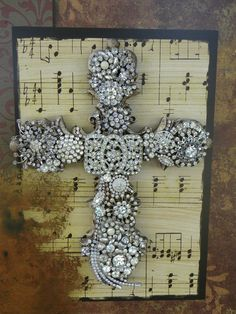 Random vintage jewelry pieced together over sheet music