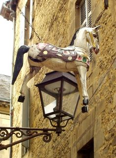 Sign Flying Horse and lamp post, Sarlat, Dordogne, France. Pub Signs, Shop Signs, Storefront Signs, French Signs, Store Signage, Entrance Sign, Roadside Attractions, Shop Fronts, Street Lamp