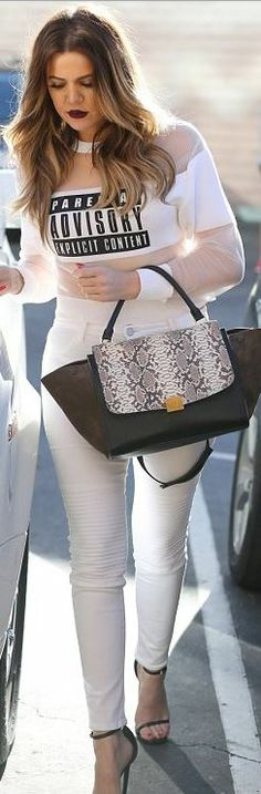Khloe Kardashian: Shirt – Alexander Wang  Purse – Celine  Jeans – J Brand  Shoes – Saint Laurent