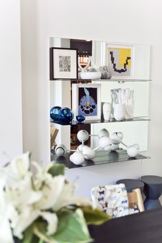 Shelves backed with mirrors reflect light and make your room appear larger. #refinery29 http://www.refinery29.com/small-space-living#slide-26