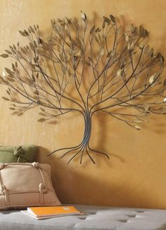 Metal Tree Artwork.  This with various family pictures surrounding it :)