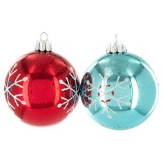 """Haul out the holly, put up the tree before your spirit falls again! Get into the spirit of the season by trimming your tree with the season's best! Aqua & Red Glossy Ball Ornaments with Snowflakes feature a gloss finish and white glitter snowflakes with red and blue glitter accents. These gorgeous ornaments are lightweight, constructed of plastic, and shatter proof. Make your Christmas merry and bright! Dimensions: Width: 2"""" Each box contains 12 ornaments."""