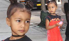 Kim Kardashian's daughter North West holds onto a lollipop