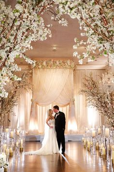 Couple at Elegant Ceremony with Divine Chuppah | Photography: Bob & Dawn…