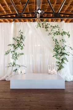 Rustic Draped Wedding Ceremony Backdrop with Modern Greenery and Candles