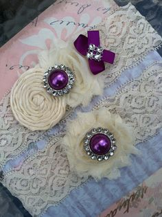 ivory/ dark purple wedding garter / bridal  garter/  lace garter / toss garter / wedding garter / vintage inspired lace garter. $28.99, via Etsy.