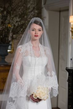 wedding dress. Long sleeves with nice collar. Could be an underlay to the dress, as it was with the Vera Wang White mass-market version of Ivanka's dress.