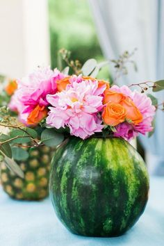 Instead of reaching for a glass vase, select fruit for vases for your summer party. These hollowed out fruits make adorable vases for summer centerpieces.