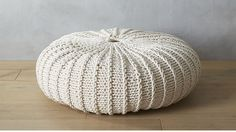 "jumbo knit natural pouf - 31.5""dia x 9""h - $199 (less 15% is $169.15) - to nest underneath the coffee table"