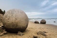 Naturally forming spherical boulders at Moeraki, New Zealand
