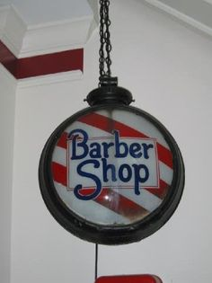 An unusual shape for a Barber sign...