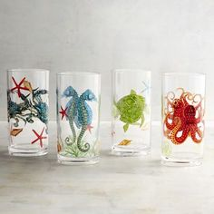 Now here's a charming quartet you'll want to invite to every party. Our sturdy acrylic tumblers are ready to entertain with a cast of undersea characters in charming coastal shades that'll look great either by the pool or on the deck with friends.