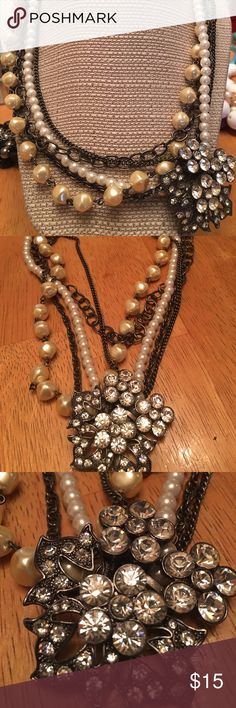 Romantic style Vintage looks. I believe this came from Limited. Multiple strands of pearls with floral accent piece, encrusted with crystals. Great condition. Jewelry Necklaces