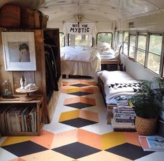 The link doesn't have any more info than this picture, but I love the open space in this bus conversion. I'm not sure the design on the floor is for me--I think it would look dated very quickly. I do like the rustic wood.