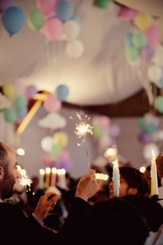 celebration in tent with a roof full of baloons