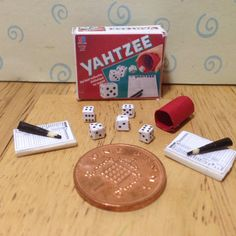 A personal favourite from my Etsy shop https://www.etsy.com/uk/listing/503891370/dolls-house-miniature-replica-yahtzee