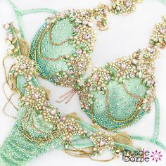 Make your own sizzling fashion statement. A WBFF style competition bikini featuring light gold, pink and green crystals and rhinestones with chains and lace on a mint green fabric. Festival Costumes, Festival Outfits, Carribean Carnival Costumes, Bling Bra, Wbff Bikini, Samba Costume, Bikini Competition Suits, Costumes Around The World, Bh Set