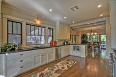Paint the kitchen white, stainless steel pulls and install recessed lighting.