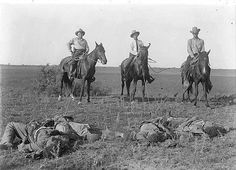 Texas Rangers with dead Mexican rebels, the morning after the Norias Ranch Raid, August 9, 1915.
