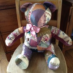 Crazy quilt, embroidered teddy bear by my mother.
