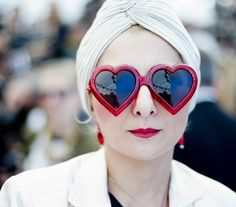 Catherine Baba wearing a turban and Jeremy Scott x Linda Farrow heart sunglasses at the Louis Vuitton show at Paris Fashion Week (Spring/Summer 2012).