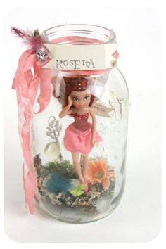 craft idea at a birthday party...mason jars? sculpty clay to fix the figurine? cute ribbon and feather to finish it off! Makes a great fairy vignette!