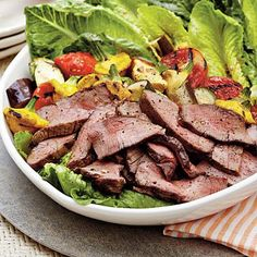 Grilled Steak-and-Ratatouille Salad with Basil-Garlic Vinaigrette | Grilled veggies, crisp lettuce, and tender beef fillets make up this summertime salad. | #Recipes | SouthernLiving.com