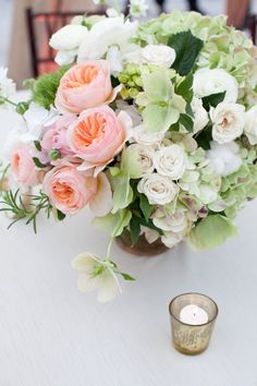 #roses #hydrangeas #centerpiece  Photography by gaylebrooker.com  Event Design + Coordination by southernprotocol.com/  Floral Design by charlestonstems.com/    Read more - http://www.stylemepretty.com/2013/07/08/charleston-wedding-from-gayle-brooker/