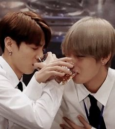 Jungkook Taehyung drink Kookie looks like he doesn't enjoy it at allour little bunny << feat taetae holding his titty