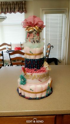 Five tear tribal themed diaper cake. Of corse with the expected little girls name.