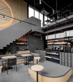 A Material Palette Of Warm Woods And Grey Elements Has Been Used To Create This Contemporary Coffee Shop Interior - hOteLs - Coffee Coffee Shop Interior Design, Interior Design Minimalist, Coffee Shop Design, Restaurant Interior Design, Modern Restaurant, Coffee Cafe Interior, Palette, Loft Cafe, Furniture Layout