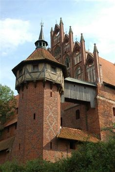 Malbork castle,Poland. Malbork became more important in the aftermath of the Teutonic Knights' conquest of Gdańsk (Danzig) and Pomerania in 1308. The Order's administrative centre was moved to Malbork from Elbląg (Elbing). The Grand Master of the Teutonic Knights, Siegfried von Feuchtwangen, who arrived in Malbork from Venice, undertook the next phase of the fortress' construction.