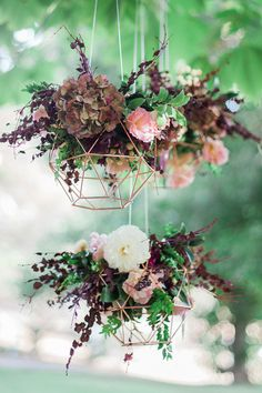 Suspended Floral Geo Shapes As Wedding Decor ~ love the deep purple palette with hydrangea, dahlia, roses and maybe barberry? Bella In Bloom