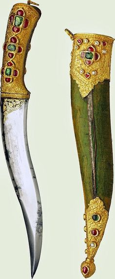 Indian pesh kabz dagger, steel, gold, emerald, rubies, pearls and cotton covered wood. The Royal Collection Trust.
