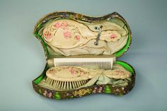 Victorian celluloid box with a brush, comb and mirror