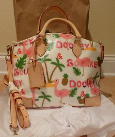 """Dooney & Bourke """"Flamingo"""" purse  i love dooney and i love flamingos!!! the only problem is that the legs are going the wrong way :("""