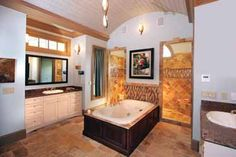 Love the barrel ceiling and walk in shower as well as his and her sinks. Not sure about exposed bathtub in middle, may work.