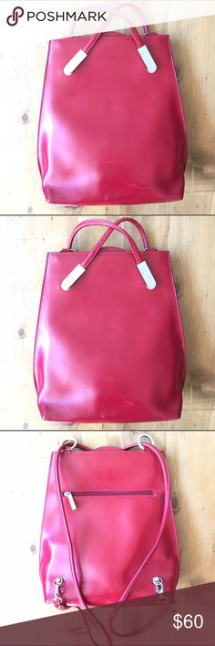 Fredric T Paris Red Bag Great condition one small mark at the bottom of bag see pick one side pocket inside with zipper metal clasps shuts inside is very clean can be worn as a backpack or purse 24 in with straps 12 in deep 12 in wide this is a wonderful bag Frederic T  Bags