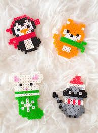 Have fun making these adorable Christmas perler bead patterns with your kids. They're loads of fun and super easy with our handy printable pattern templates Christmas Perler Bead Patterns Easy Perler Bead Patterns, Melty Bead Patterns, Diy Perler Beads, Perler Bead Art, Beading Patterns, Mosaic Patterns, Bracelet Patterns, Loom Patterns, Perler Bead Ornaments Pattern