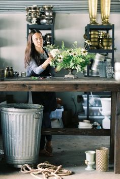 big, tall wood table with durable top, big garbage can, racks for hard goods...Honey of a Thousand Flowers // Sarah Winward