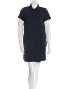 Navy A.P.C. short sleeve mini dress with pointed collar, dual patch pockets at bust, slit pockets at hips, tonal stitching throughout and button closures at center front.