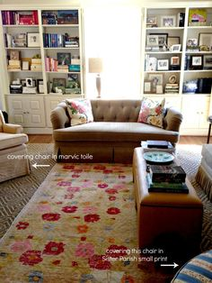 """I love her bookcases and how she arranged books by subject and color and filled with little frames memories like this below . . . And I like that her books are actual books from her childhood and on up into adulthood as her interests changed. It's a blending of things not just an attempt to decorate and go out buy books just because of their spine color. Their bookcases really tell a story of their lives and interests."""