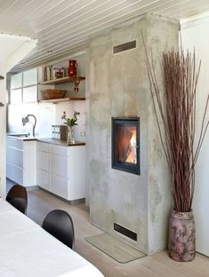 An added fireplace in a narrow space. On the far side of the fireplace there is built in spot for firewood. Nice kitchen too! Small Space Living, Living Spaces, Barn House Conversion, Before After Kitchen, Timber Flooring, White Kitchen Cabinets, Scandinavian Design, Cool Kitchens, Countertops