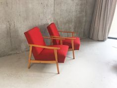 Very attractive pair of mid century modern lounge armchairs with a great shape and in fantastic condition.  The wonderful brightly coloured upholstery is original. Extremely comfortable